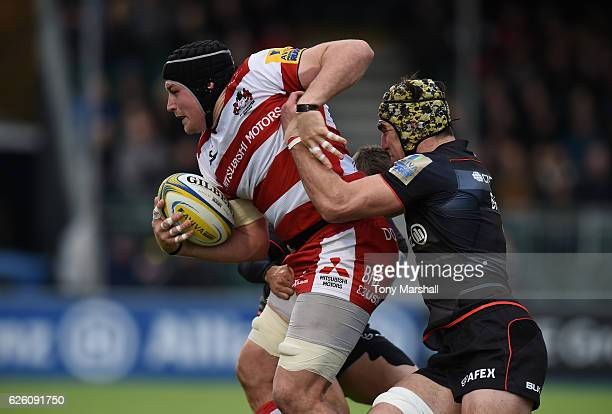 Kelly Brown and Richard Wigglesworth of Saracens tackle Ben Morgan of Gloucester Rugby during the Aviva Premiership match between Saracens and...