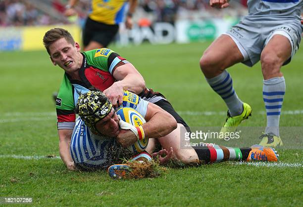Kelly Brown is blocked for a try by Tom Williams of Harlequins during the Aviva Premiership match between Harlequins and Saracens at Twickenham Stoop...
