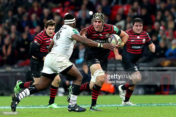 Kelly Brown of Saracens hands off Chilliboy Ralepelle of Toulouse during the Heineken Cup pool three match between Saracens and Toulouse at Wembley...