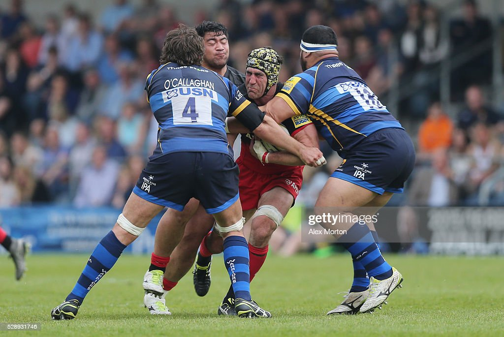 <a gi-track='captionPersonalityLinkClicked' href=/galleries/search?phrase=Kelly+Brown+-+Rugby+Player&family=editorial&specificpeople=211000 ng-click='$event.stopPropagation()'>Kelly Brown</a> of Saracens is tackled by <a gi-track='captionPersonalityLinkClicked' href=/galleries/search?phrase=Donncha+O%27Callaghan&family=editorial&specificpeople=544076 ng-click='$event.stopPropagation()'>Donncha O'Callaghan</a> and James Johnston during the Aviva Premiership match between Worcester Warriors and Saracens at Sixways Stadium on May 7, 2016 in Worcester, England.