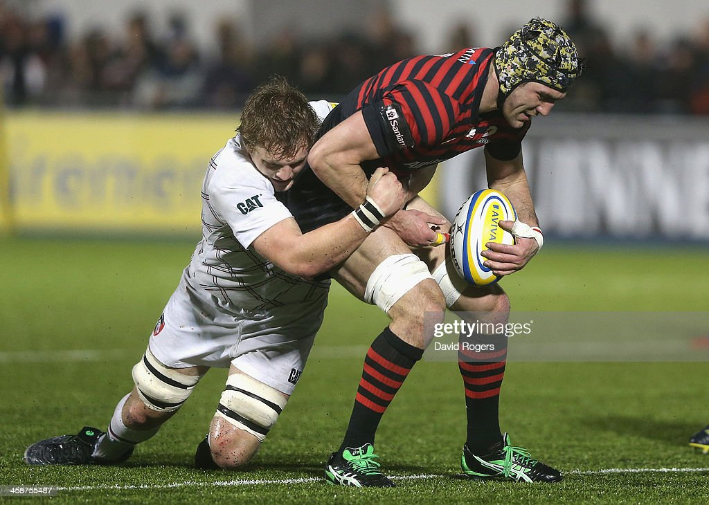 <a gi-track='captionPersonalityLinkClicked' href=/galleries/search?phrase=Kelly+Brown+-+Rugby+Player&family=editorial&specificpeople=211000 ng-click='$event.stopPropagation()'>Kelly Brown</a> of Saracens is tackled by Jamie Gibson during the Aviva Premiership match between Saracens and Leicester Tigers at Allianz Park on December 21, 2013 in Barnet, England.
