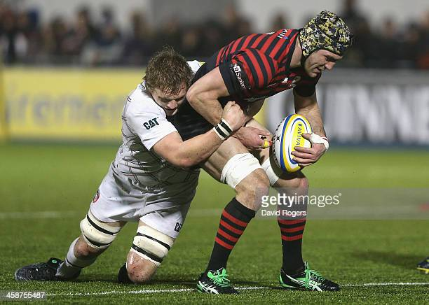 Kelly Brown of Saracens is tackled by Jamie Gibson during the Aviva Premiership match between Saracens and Leicester Tigers at Allianz Park on...