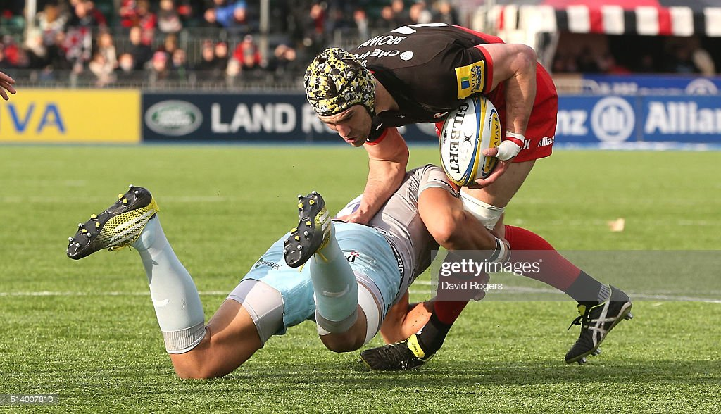 <a gi-track='captionPersonalityLinkClicked' href=/galleries/search?phrase=Kelly+Brown+-+Rugby+Player&family=editorial&specificpeople=211000 ng-click='$event.stopPropagation()'>Kelly Brown</a> of Saracens is tackled by <a gi-track='captionPersonalityLinkClicked' href=/galleries/search?phrase=Luther+Burrell&family=editorial&specificpeople=871965 ng-click='$event.stopPropagation()'>Luther Burrell</a> during the Aviva Premiership match between Saracens and Northampton Saints at Allianz Park on March 5, 2016 in Barnet, England.