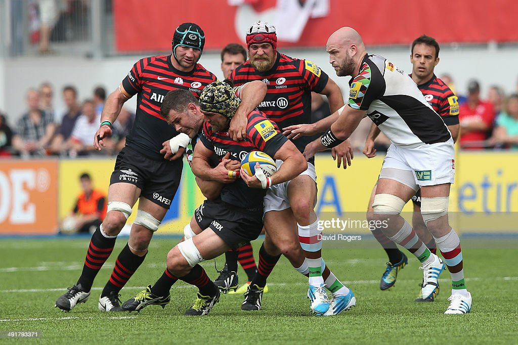 <a gi-track='captionPersonalityLinkClicked' href=/galleries/search?phrase=Kelly+Brown&family=editorial&specificpeople=211000 ng-click='$event.stopPropagation()'>Kelly Brown</a> of Saracens is tackled by <a gi-track='captionPersonalityLinkClicked' href=/galleries/search?phrase=Nick+Easter&family=editorial&specificpeople=686040 ng-click='$event.stopPropagation()'>Nick Easter</a> during the Aviva Premiership semi final match between Saracens and Harlequins at Allianz Park on May 17, 2014 in Barnet, England.