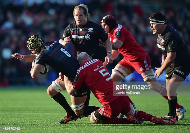Kelly Brown of Saracens is tackled by Paul O'Connell of Munster during the European Rugby Champions Cup match between Saracens and Munster Rugby at...