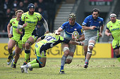Kelly Brown of Saracens is tackled by Will Addison of Sale Sharks during the Aviva Premiership match between Sale Sharks and Saracens at AJ Bell...