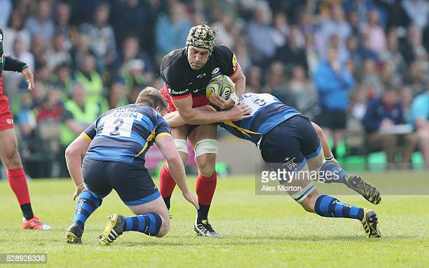 Kelly Brown of Saracens is tackled during the Aviva Premiership match between Worcester Warriors and Saracens at Sixways Stadium on May 7 2016 in...