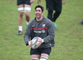Kelly Brown runs with the ball during the Saracens training session held at the Saracens media day held at their training ground on April 22 2014 in...