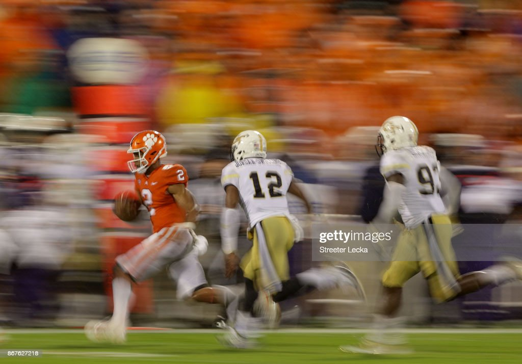 Kelly Bryant #2 of the Clemson Tigers runs away from Bruce Jordan-Swilling #12 of the Georgia Tech Yellow Jackets during their game at Memorial Stadium on October 28, 2017 in Clemson, South Carolina.