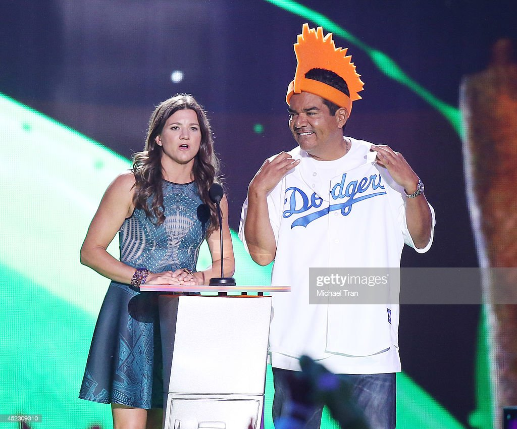 Kelly Clark and Actor George Lopez speak onstage during the Nickelodeon Kids' Choice Sports Awards 2014 held at Pauley Pavilion on July 17 2014 in...