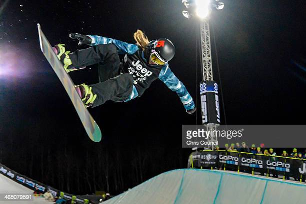 Kelly Clark flies through the air on her way to earning her fourth gold medal in the Winter XGames 2014 women's Snowboard Superpipe final at Winter...