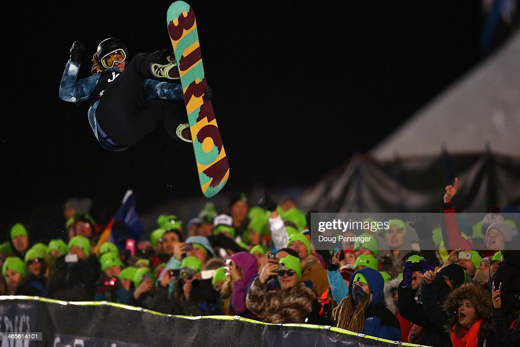 Kelly Clark spins above the pipe and spectators en route to winning the women's Snowboard Superpipe at Winter X-Games 2014 Aspen at Buttermilk Mountain on January 25, 2014 in Aspen, Colorado.