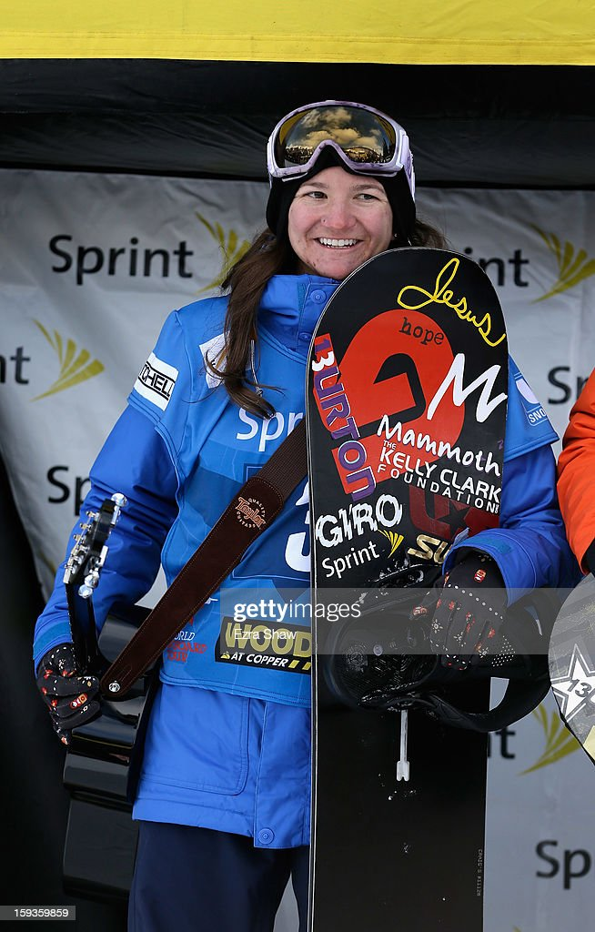 Kelly Clark stands on the podium after placing second in the FIS Snowboard World Cup Half Pipe ladies' final at the US Grand Prix on January 12, 2013 in Copper Mountain, Colorado.