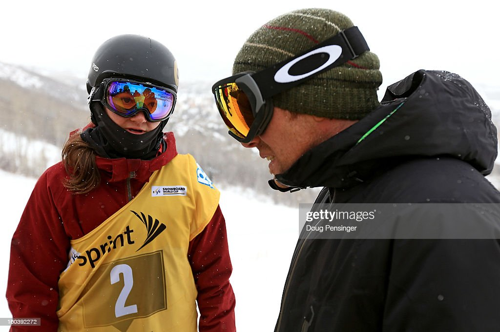 Kelly Clark talks with Mike Jankowski, Head Coach - Halfpipe & Slopestyle - US Olympic Team - US Snowboarding & US Freeskiing, during qualifications for the FIS Snowboard Halfpipe World Cup at the Sprint U.S. Grand Prix at Park City Mountain on January 30, 2013 in Park City, Utah.