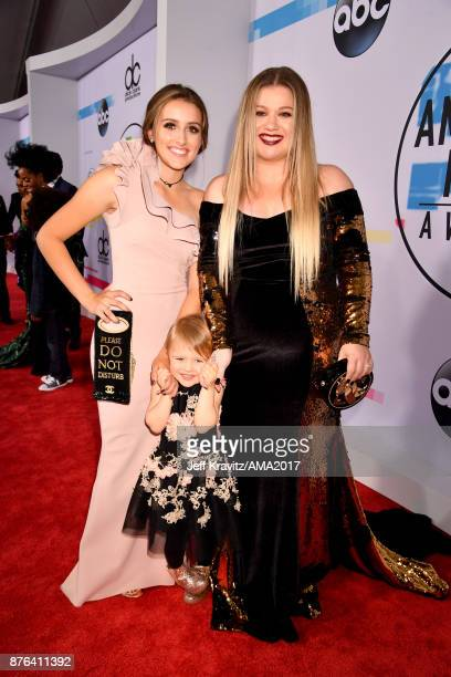 Kelly Clarkson and guest attend the 2017 American Music Awards at Microsoft Theater on November 19 2017 in Los Angeles California