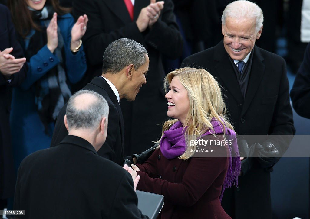 Kelly Clarkson greets U.S. President Barack Obama after performing during the presidential inauguration on the West Front of the U.S. Capitol January 21, 2013 in Washington, DC. Barack Obama was re-elected for a second term as President of the United States.