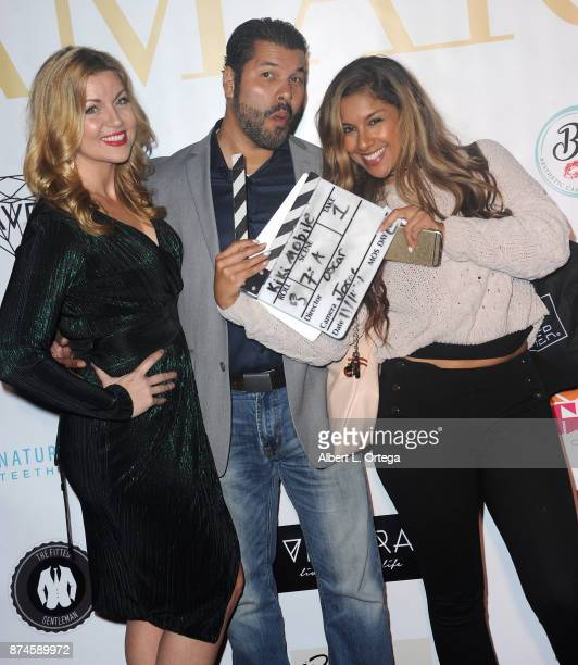 Kelly Dolan and Sal Velez Jr attend Amare Magazine Presents A Black Tie Event featuring cover model Mike O'Hearn held at Hangar 21 on November 14...