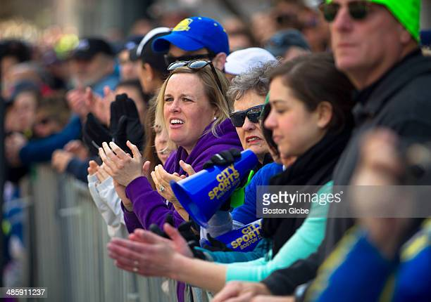 Kelly Early of Cambridge cheered on the early finishers on Boylston Street among a sea of spectators at the 118th Boston Marathon on Monday April 21...