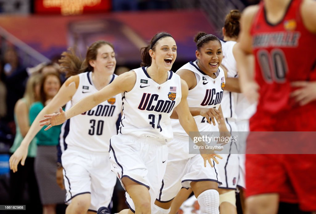 Kelly Faris #34, Breanna Stewart #30 and Kaleena Mosqueda-Lewis #23 of the Connecticut Huskies run onto the court after defeating the Louisville Cardinals during the 2013 NCAA Women's Final Four Championship at New Orleans Arena on April 9, 2013 in New Orleans, Louisiana.