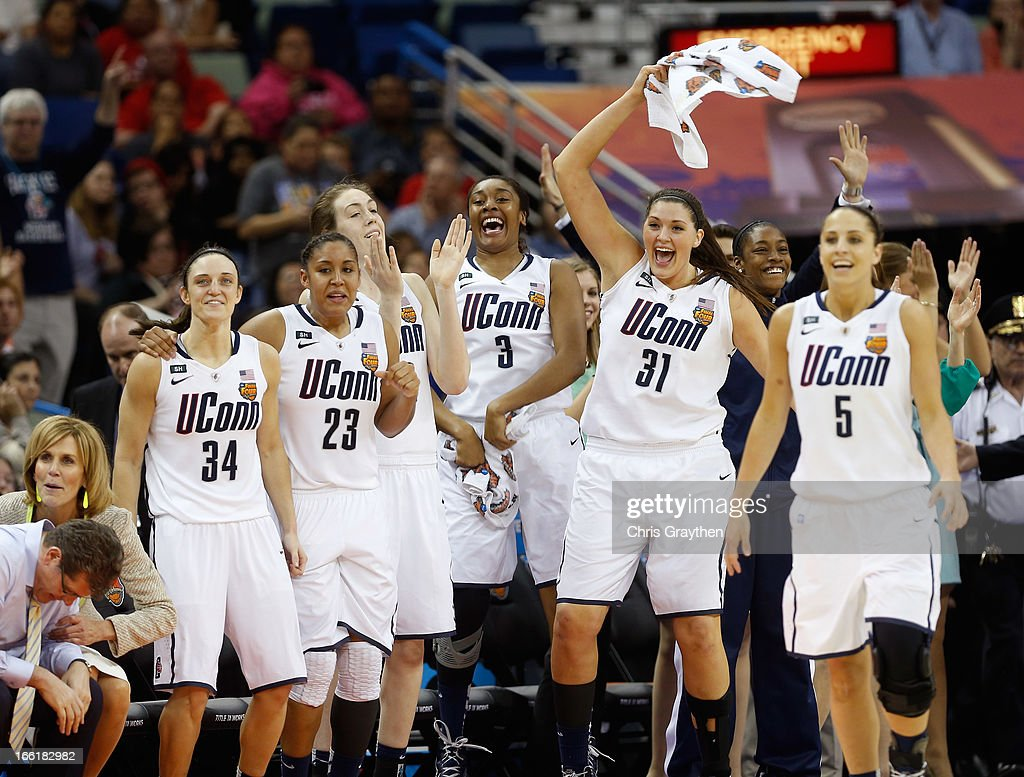Kelly Faris #34, Kaleena Mosqueda-Lewis #23, Breanna Stewart #30, Morgan Tuck #3, Stefanie Dolson #31 and Caroline Doty #5 of the Connecticut Huskies celebrate late in the game against the Louisville Cardinals during the 2013 NCAA Women's Final Four Championship at New Orleans Arena on April 9, 2013 in New Orleans, Louisiana.