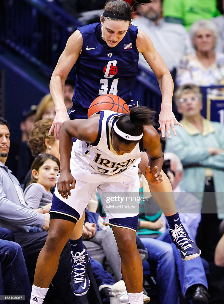 Kelly Faris #34 of the Connecticut Huskies and Jewell Loyd #32 of the Notre Dame Fighting Irish battle for a loose ball at Purcel Pavilion on March 4, 2013 in South Bend, Indiana.