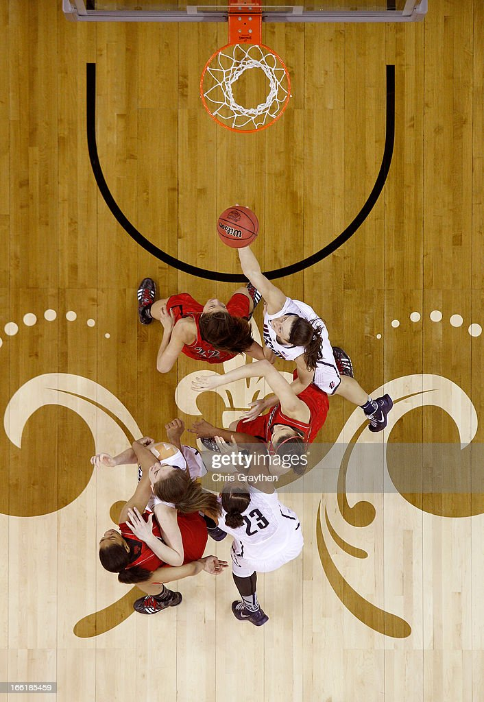 Kelly Faris #34 of the Connecticut Huskies goes up with the ball against Jude Schimmel #22 of the Louisville Cardinals during the 2013 NCAA Women's Final Four Championship at New Orleans Arena on April 9, 2013 in New Orleans, Louisiana.