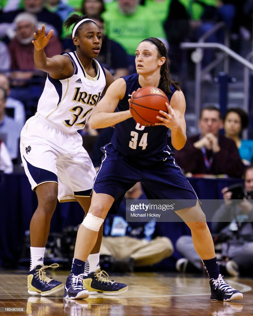 Kelly Faris #34 of the Connecticut Huskies holds the ball as Jewell Loyd #32 of the Notre Dame Fighting Irish defends at Purcel Pavilion on March 4, 2013 in South Bend, Indiana. Notre Dame defeated Connecticut 96-87 in triple overtime to win the Big East regular season title.