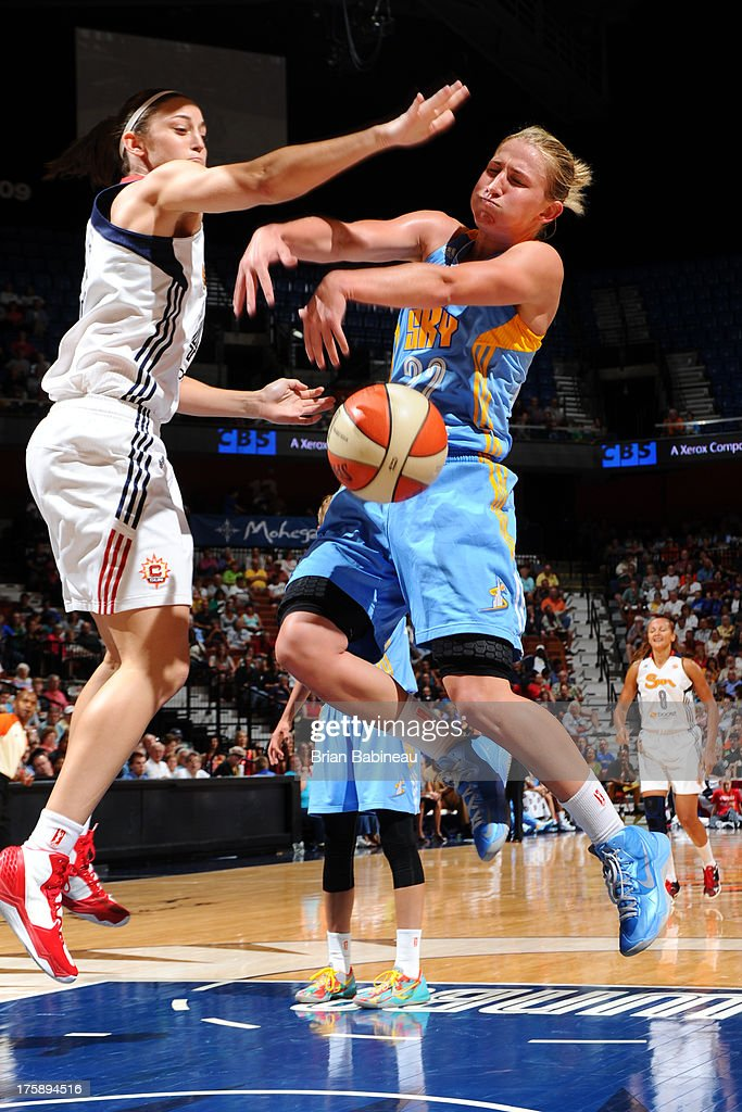 Kelly Faris #34 of the Connecticut Sun blocks Courtney Vandersloot #22 of the Chicago Sky on August 9, 2013 at the Mohegan Sun in Uncasville, Connecticut.