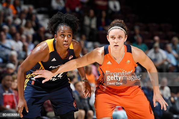 Kelly Faris of the Connecticut Sun boxes out against Shenise Johnson of the Indiana Fever on September 13 2016 at the Mohegan Sun Arena in Uncasville...