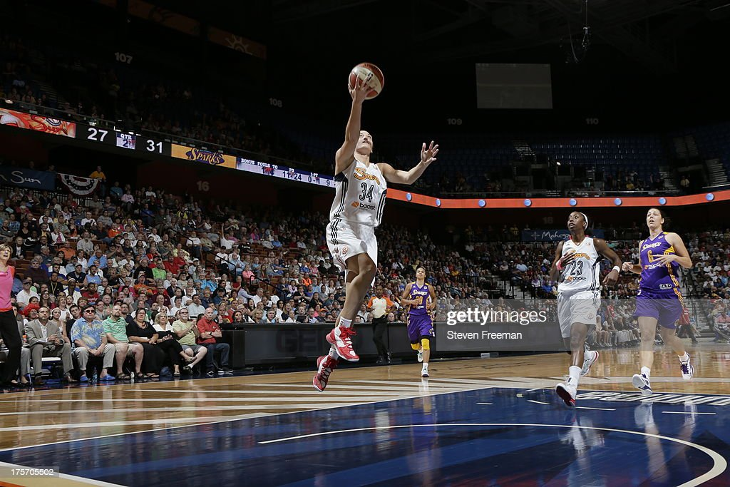 Kelly Faris # 34 of the Connecticut Sun drives against the Los Angeles Sparks during a game on August 6, 2013 at Mohegan Sun Arena in Uncasville, Connecticut.