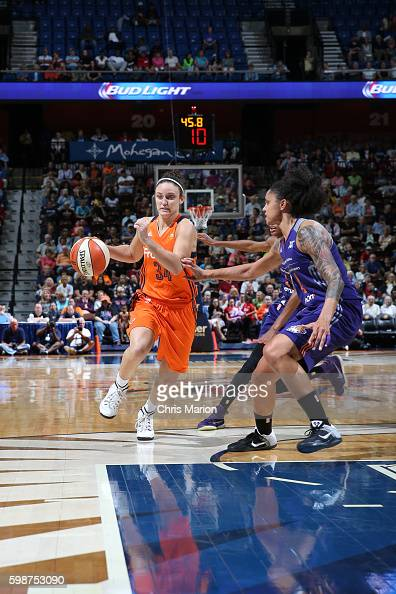 Kelly Faris of the Connecticut Sun drives to the basket against the Phoenix Mercury during a WNBA game on September 2 2016 at the Mohegan Sun Arena...