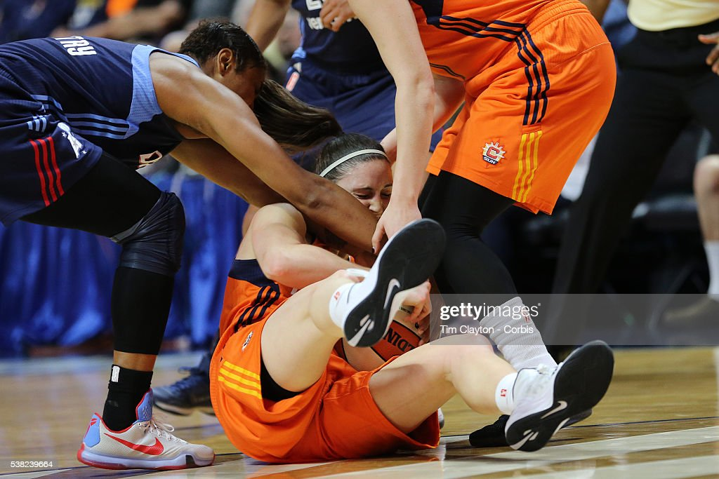 Kelly Faris of the Connecticut Sun fighting for a steal with Angel McCoughtry of the Atlanta Dream during the Atlanta Dream Vs Connecticut Sun WNBA...