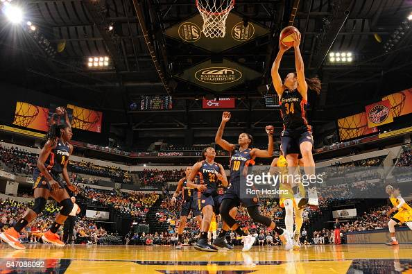 Kelly Faris of the Connecticut Sun grabs the rebound against the Indiana Fever at Bankers Life Fieldhouse on July 13 2016 in Indianapolis Indiana...