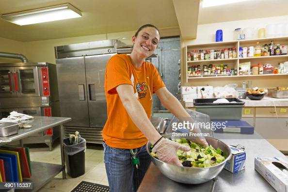 Kelly Faris of the Connecticut Sun serve meals at the New London Community Meal Center as part of WNBA Cares Week on May 12 2014 in New London...