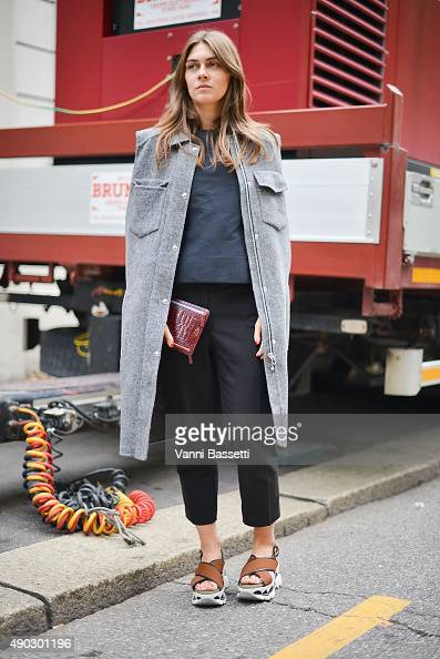 Kelly Flynn poses wearing an Alexander Wang coat and Marni shoes before the Marni show during the Milan Fashion Week Spring/Summer 16 on September 27...