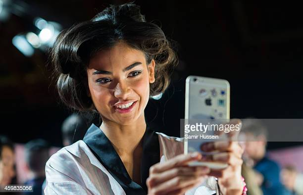 Kelly Gale poses backstage at the annual Victoria's Secret fashion show at Earls Court on December 2 2014 in London England