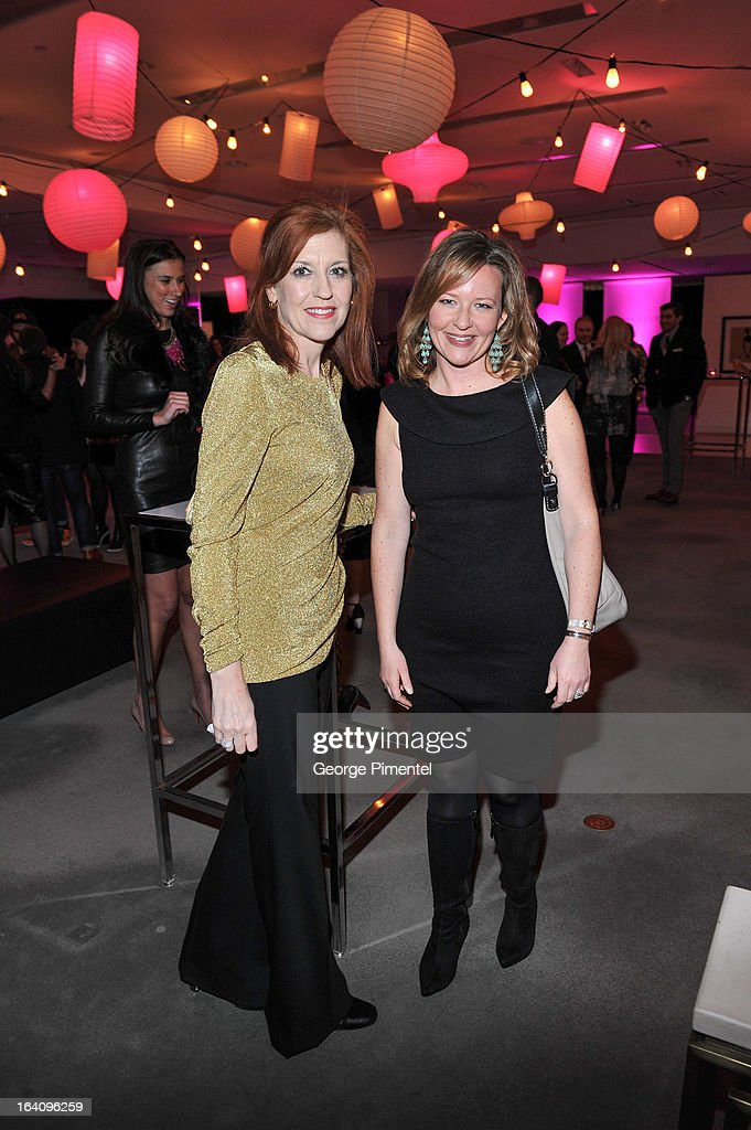 Kelly Golby and Jennifer Reynolds attend the Holt Renfrew opening night party on March 18, 2013 in Toronto, Canada.