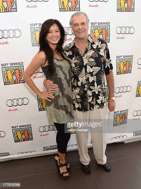 Kelly Hu and Tom Hallick attend the Best Buddies Poker Event at Audi Beverly Hills on August 22 2013 in Beverly Hills California