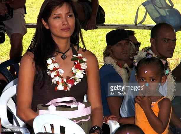 Kelly Hu and village child during Kelly Slater Invitational Fiji Day 2 Mome Village Tour in Mome Village Tavarua Island Fiji