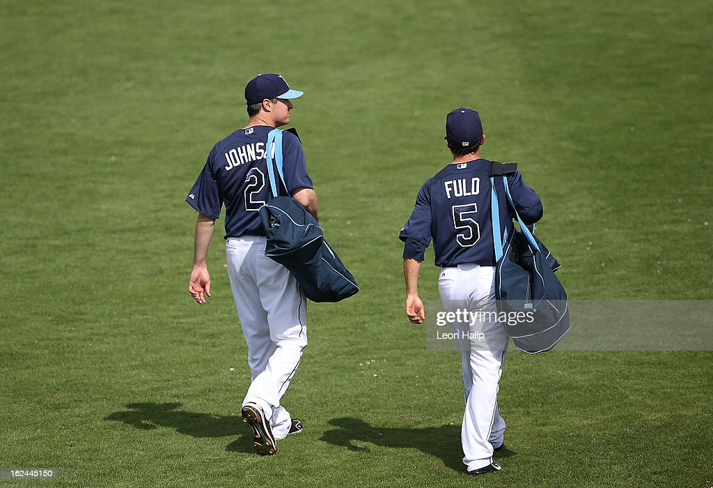 Kelly Johnson #2 and Sam Fuld #5 of the Tampa Bay Rays walk to the clubhouse during the Spring Training game against the Pittsburgh Pirates on February 23, 2013 in Port Charlotte, Florida. The Pirates defeated the Rays' 3-2.