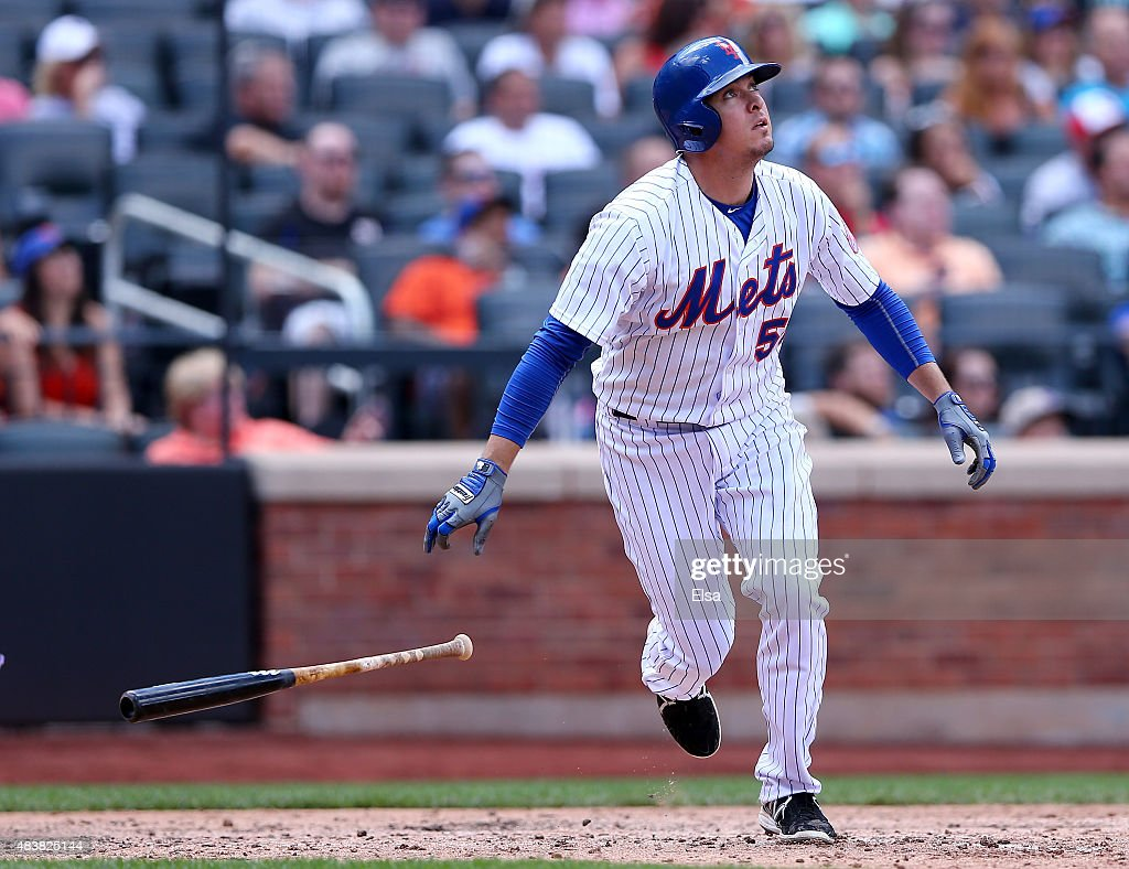 Kelly Johnson #55 of the New York Mets hits a solo home run in the fifth inning against the Colorado Rockies on August 13, 2015 at Citi Field in the Flushing neighborhood of the Queens borough of New York City.