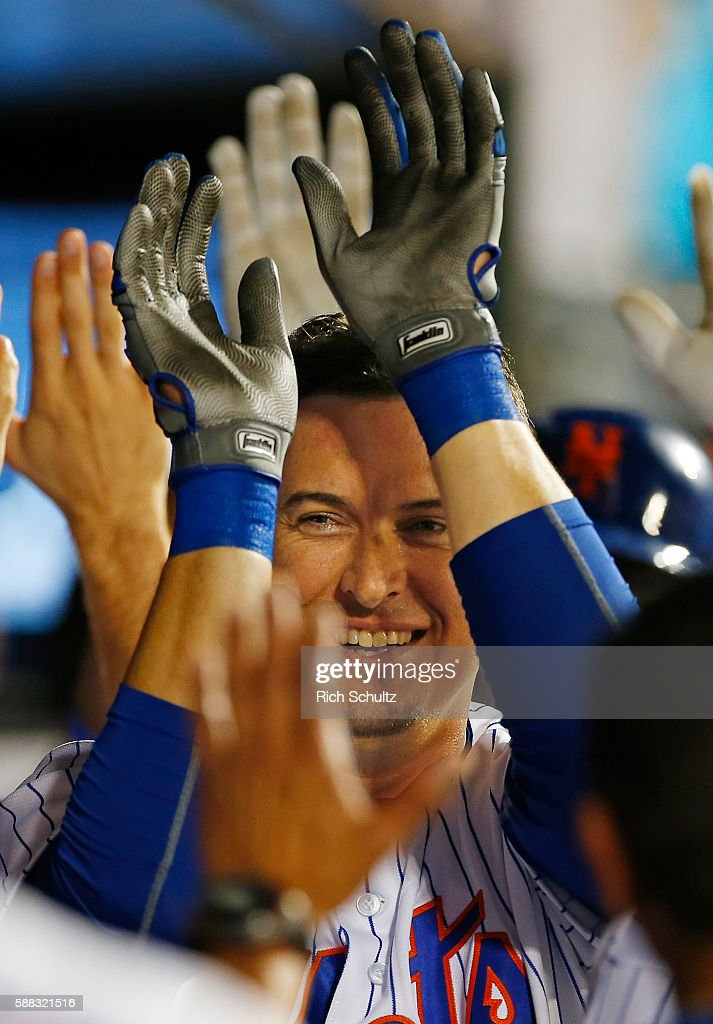 Kelly Johnson #55 of the New York Mets is congratulated by teammates after he hit a two run home run in the ninth inning to tie the game against the Arizona Diamondbacks at Citi Field on August 10, 2016 in the Flushing neighborhood of the Queens borough of New York City.
