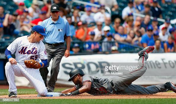 Kelly Johnson of the New York Mets is late with the tag as Socrates Brito of the Arizona Diamondbacks steals third base in the fourth inning at Citi...