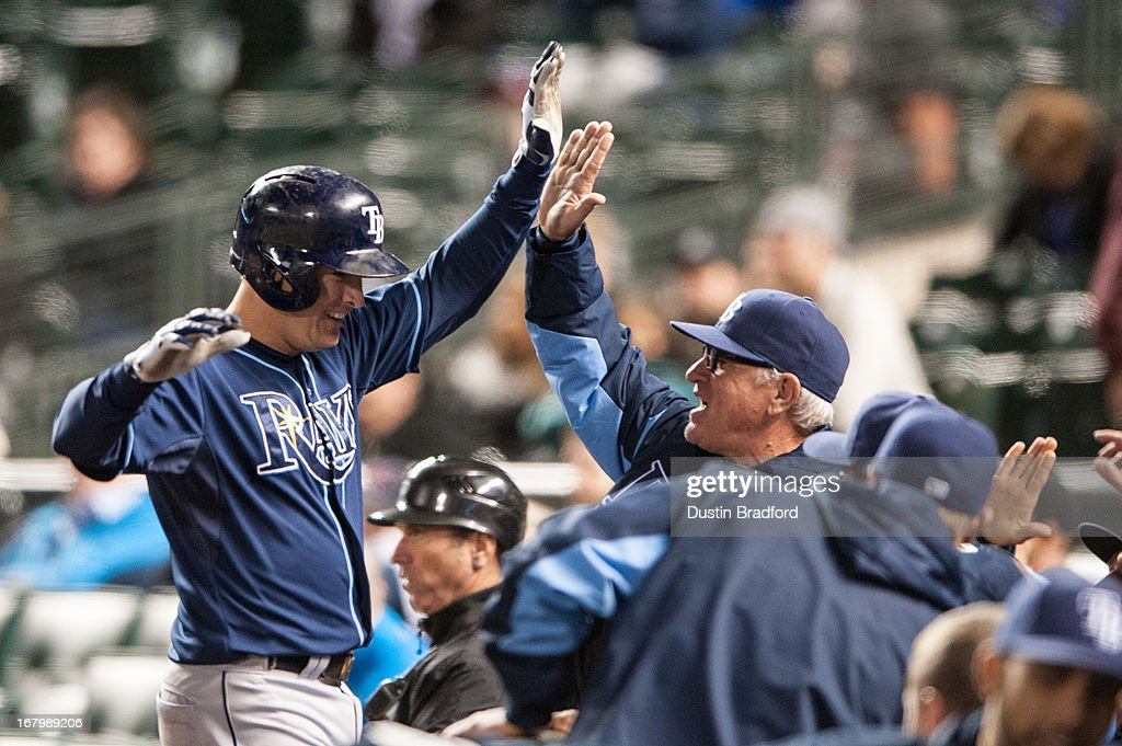 Kelly Johnson #2 of the Tampa Bay Rays celebrates a 10th-inning two-run home run with manager <a gi-track='captionPersonalityLinkClicked' href=/galleries/search?phrase=Joe+Maddon&family=editorial&specificpeople=568433 ng-click='$event.stopPropagation()'>Joe Maddon</a> #70 during a game against the Colorado Rockies at Coors Field on May 3, 2013 in Denver, Colorado. The Rays beat the Rockies 7-4 in ten innings.