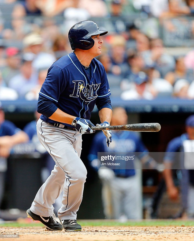 Kelly Johnson #2 of the Tampa Bay Rays follows through on a sixth inning RBI base hit against the New York Yankees at Yankee Stadium on July 27, 2013 in the Bronx borough of New York City.