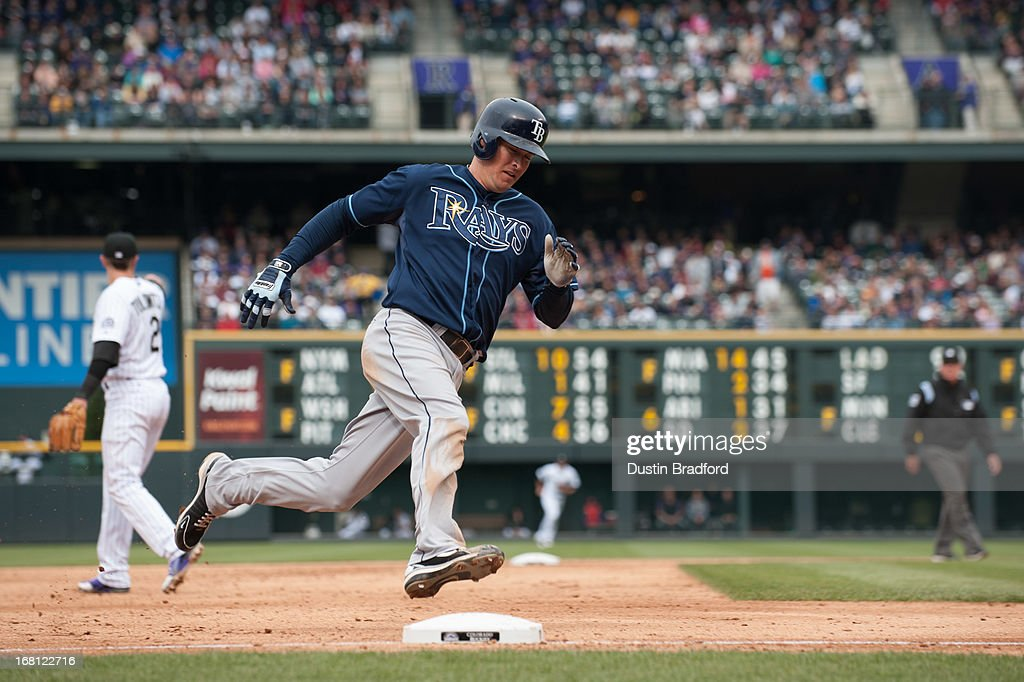 Kelly Johnson #2 of the Tampa Bay Rays rounds third base on his way to scoring a sixth inning run against the Colorado Rockies during a game at Coors Field on May 5, 2013 in Denver, Colorado.