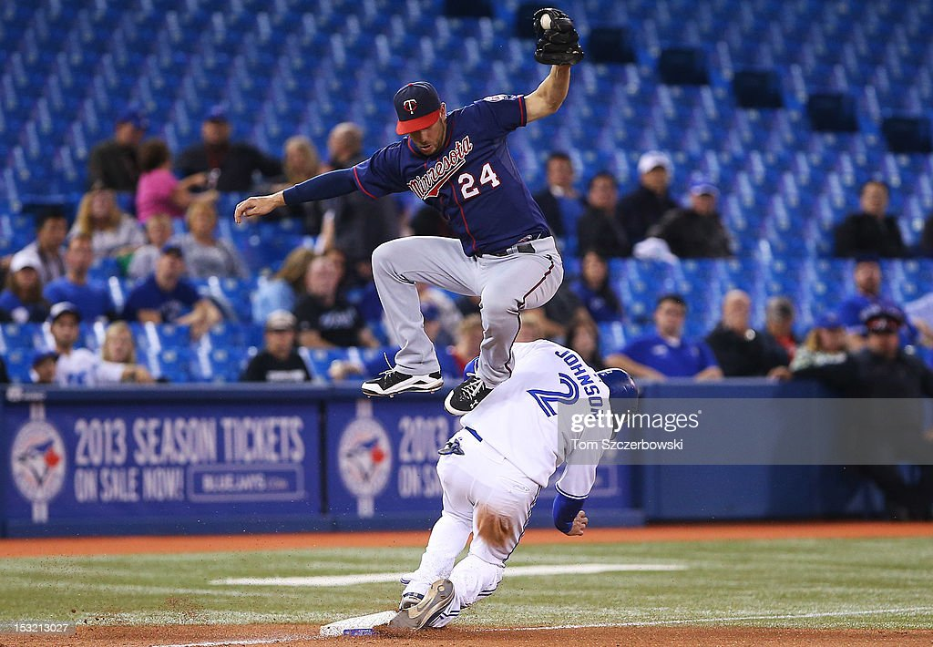 Kelly Johnson #2 of the Toronto Blue Jays steals third base in the eighth inning during MLB game action as <a gi-track='captionPersonalityLinkClicked' href=/galleries/search?phrase=Trevor+Plouffe&family=editorial&specificpeople=5722348 ng-click='$event.stopPropagation()'>Trevor Plouffe</a> #24 of the Minnesota Twins catches a high throw on October 1, 2012 at Rogers Centre in Toronto, Ontario, Canada.