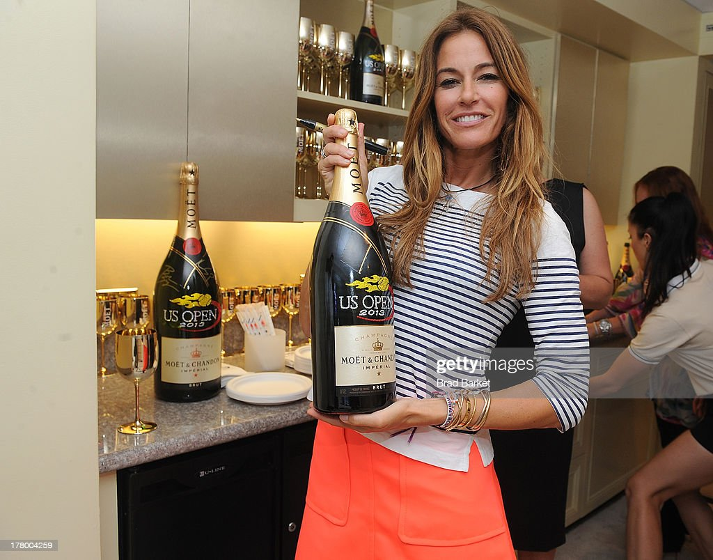 <a gi-track='captionPersonalityLinkClicked' href=/galleries/search?phrase=Kelly+Killoren+Bensimon&family=editorial&specificpeople=621950 ng-click='$event.stopPropagation()'>Kelly Killoren Bensimon</a> attends he Moet & Chandon Suite at USTA Billie Jean King National Tennis Center on August 26, 2013 in New York City.