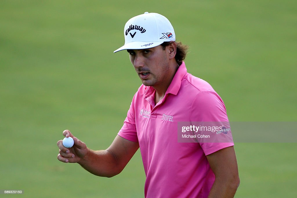 Kelly Kraft acknowledges the crowd on the eighth green during the third round of the John Deere Classic at TPC Deere Run on August 13 2016 in Silvis...