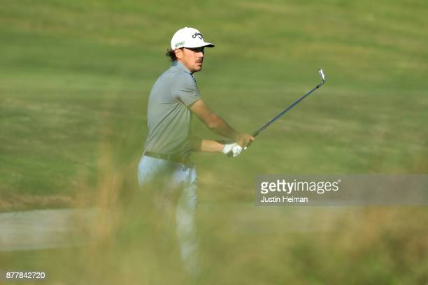 Kelly Kraft of the United States plays his second shot on the 18th hole during the final round of The RSM Classic at Sea Island Golf Club Seaside...
